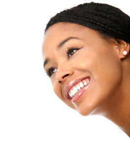 close-up-of-womans-smiling-face-over-white-no-braces